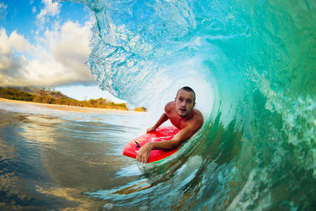 Body Boarder on Large Wave Surfing in the Tube Getting Barreled photo