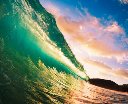 surfing beach: Beautiful Sunset Wave Stock Photo