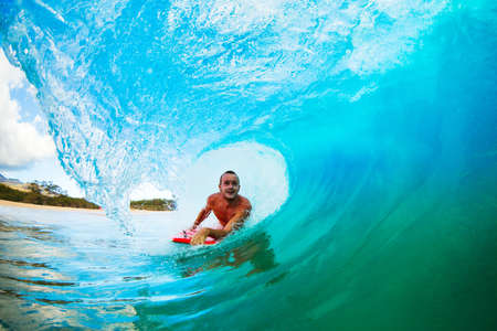 epic: Body Boarder on Large Wave Surfing in the Tube Getting Barreled