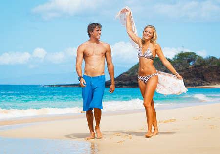 Attractive Couple Walking on Beautiful Beach