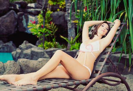 lounge: Beautiful Girl Relaxing at Tropical Resort Stock Photo