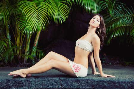 Beautiful Girl Relaxing at Tropical Resort photo