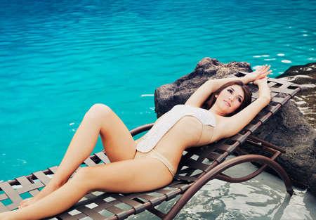 lounging: Beautiful Girl Relaxing at Tropical Resort Stock Photo