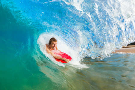 Boogie Boarder Surfing Amazing Blue Ocean Wave Stock Photo - 13613545