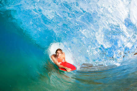 Boogie Boarder Surfing Amazing Blue Ocean Wave Stock Photo - 13613378