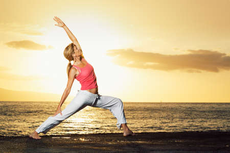 Beautiful Yoga Woman at Sunset
