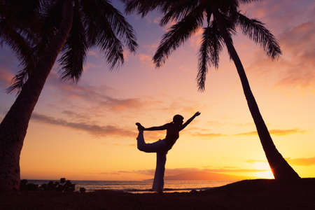 yoga sunset: Silhouette of a Beautiful Yoga Woman at Sunset