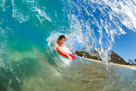 Boogie Boarder Surfing Amazing Blue Ocean Wave Stock Photo - 13613556