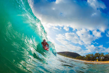 watersports: Body Boarder Surfing Blue Ocean Wave