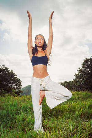 yoga woman outside in nature photo