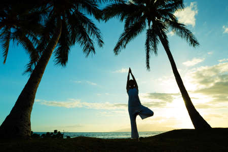 yoga sunset: Woman Doing Yoga at Sunset