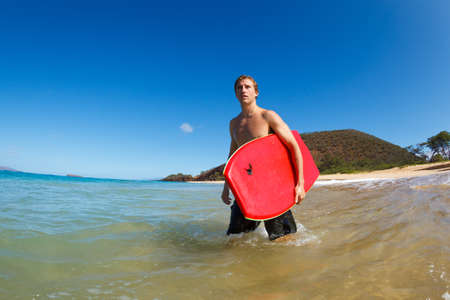 Young Man with Boogie Board at the Beach Stock Photo - 13721098