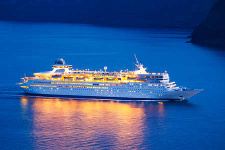 Luxury Cruise Ship Sailing at Sunset Stock Photo