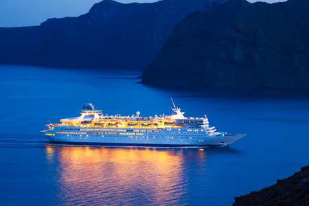 Luxury Cruise Ship Sailing at Sunset Stock Photo