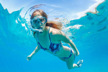 Beautiful Woman Snorkeling in Tropical Ocean Stock Photo