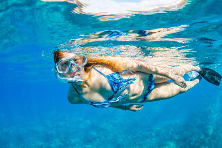 Beautiful Woman Snorkeling in Tropical Ocean photo