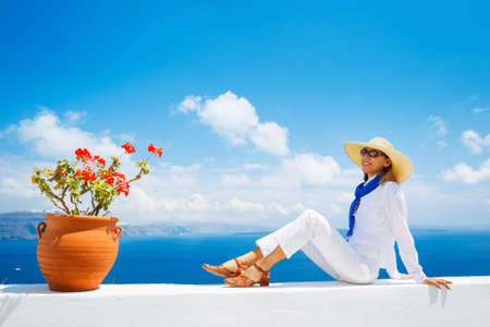Attractive Female Tourist Relaxing on Vacation on Mediterranean Island photo
