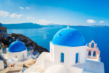 Santorini Island, Greece, Beautiful View of Blue Ocean and Traditional Dome Church Architecture  photo