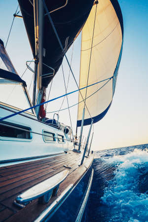 yachts: Sailing into the Sunset Stock Photo