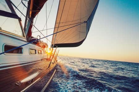 sail boat: Sailing into the Sunset Stock Photo