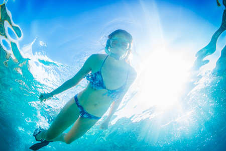 Beautiful Woman Snorkeling in Tropical Ocean photo
