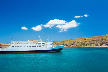 Boat in Beautiful Blue Ocean in Greek Islands Stock Photo