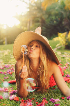 Beautiful Young Woman Blowing Bubbles