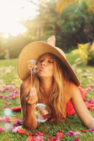 Beautiful Young Woman Blowing Bubbles