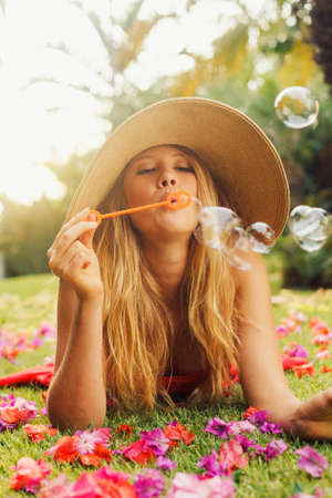 spring fashion: Beautiful Girl Blowing Bubbles