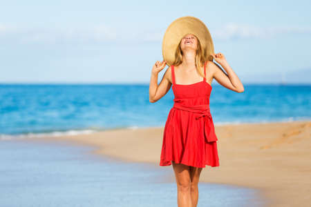 sunglasses beach: Happy Beautiful Woman in Red Dress on the Beach