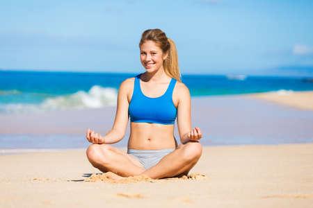 meditation room: beautiful woman relaxing on the beach in Hawai Stock Photo
