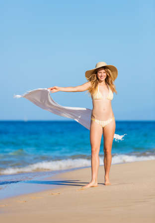 beach wear: Beautiful Woman in Bikini with White Scarf on The Beach. Travel and Vacation.
