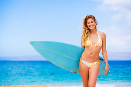 Beautiful Young Woman with Surfboard at the Beach photo