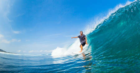 Surfer Riding Large Blue Ocean Wave Stock Photo - 16134610