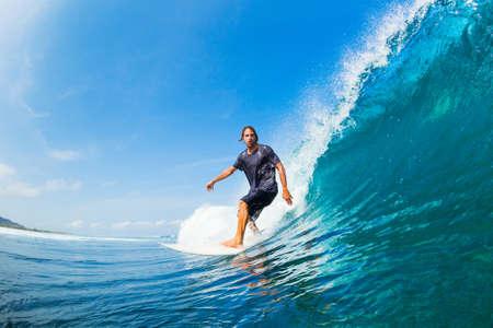 Surfer Riding Large Blue Ocean Wave Stock Photo - 16134648