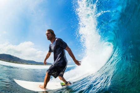 Surfer Riding Large Blue Ocean Wave Stock Photo