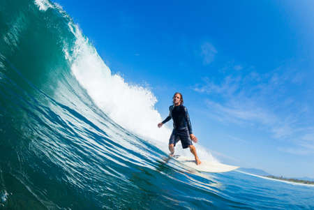 Surfer Riding Large Blue Ocean Wave Stock Photo - 16134621