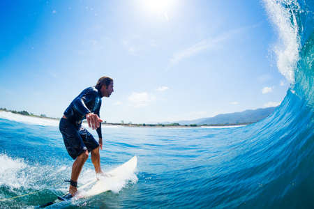 Surfer Riding Large Blue Ocean Wave Stock Photo - 16134630