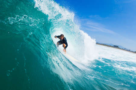 Surfer Riding Large Blue Ocean Wave photo