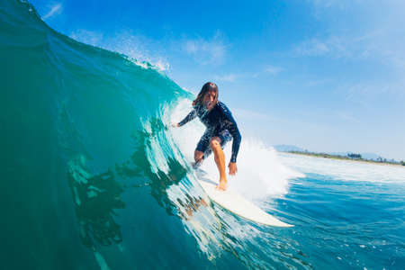 epic: Surfer Riding Large Blue Ocean Wave Stock Photo