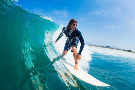 surfer: Surfer Riding Large Blue Ocean Wave Stock Photo
