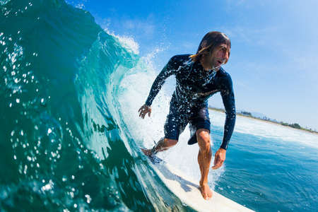 Surfer Riding Large Blue Ocean Wave Stock Photo