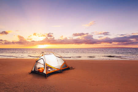 Camping on the Beach at Sunset Stock Photo