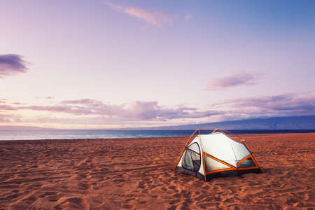 camping tent: Camping on the Beach at Sunset Stock Photo