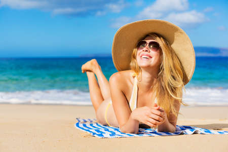 Beautiful Woman Sunbathing on Tropical Beach photo
