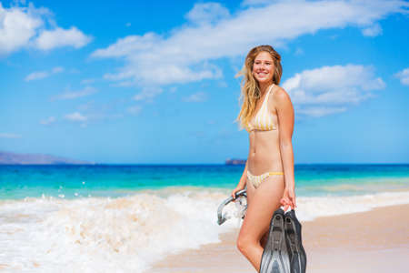 Beautiful Woman with Snorkel Gear at the Beach photo