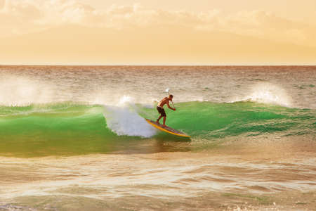 northshore: Surfer on Beautiful Wave at Sunset  Stock Photo