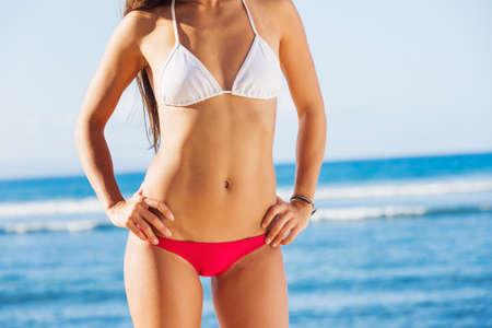 bikini island: Young beautiful woman enjoying the sun on the beach, sexy bikini