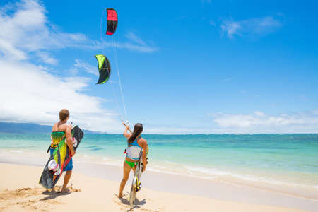 kitesurfing: Kiteboarders on Beautiful Beach