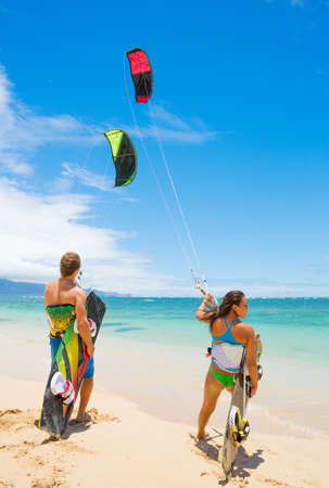 kiteboarding: Kiteboarders on Beautiful Beach